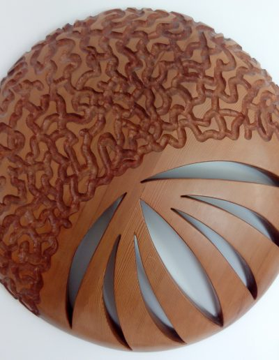 Flor. Escultura en cedro canadiense. 58 x 58 x 8 cm.